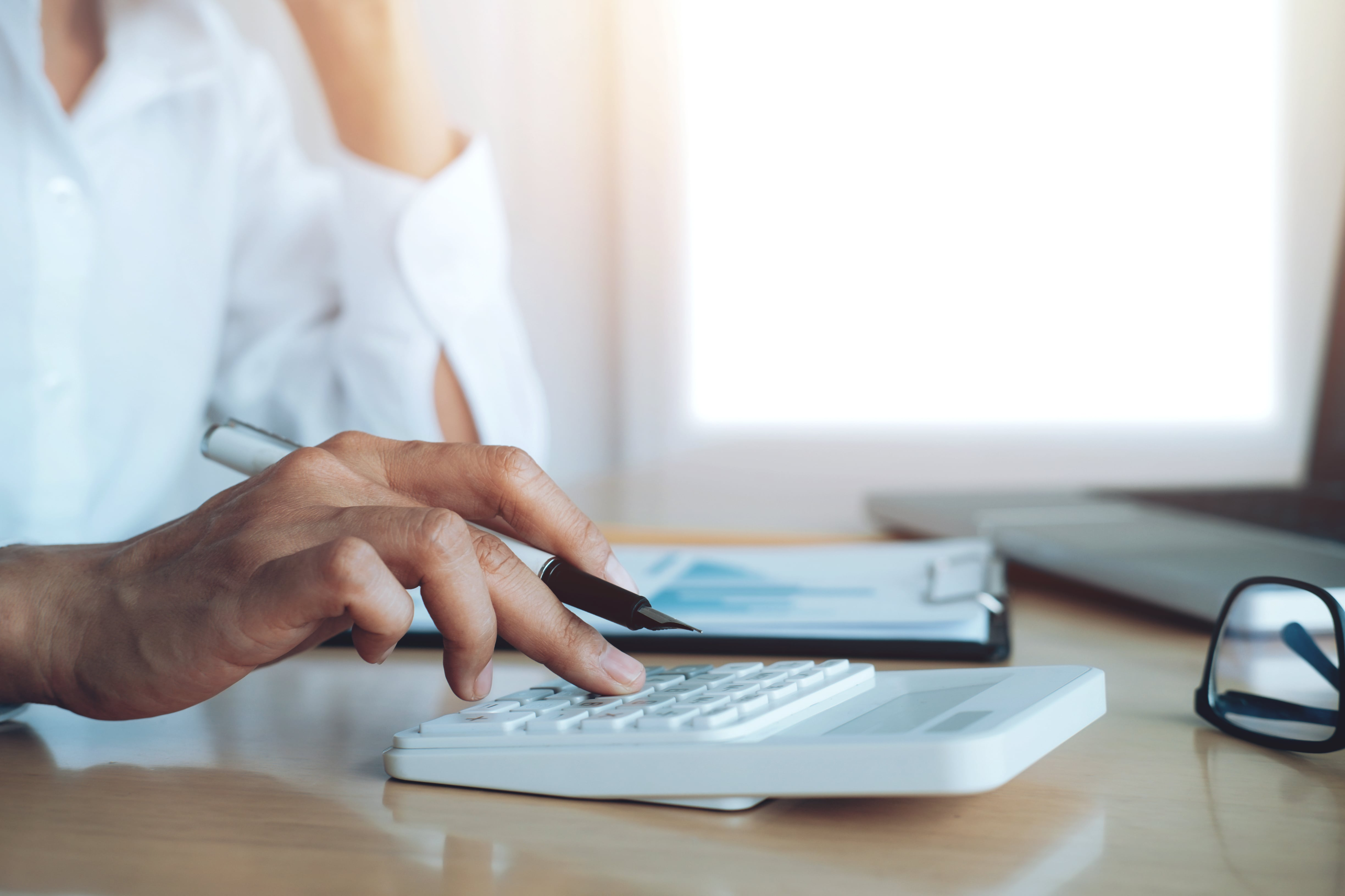 finances-saveing-economy-concept-female-accountant-banker-use-calculator-min
